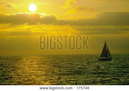 Sailboat On Ocean At Sunset