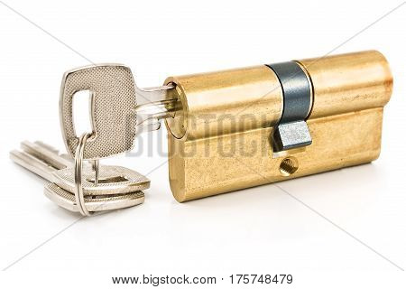Brass cartridge cylinder with keys isolated on white
