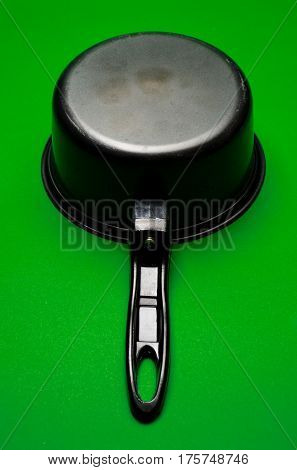old cooking equipment Kitchenware pot pan on green screen background