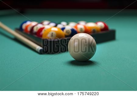 Billiard balls arranged in a triangle;selective focus on cue ball;shallow focus;