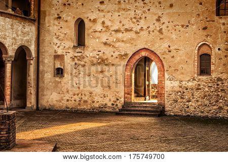Courtyard with open door in Torrechiara castle Emilia-Romagna Italy.