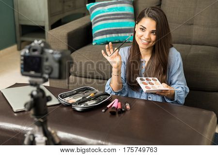 Woman Putting Makeup On Camera