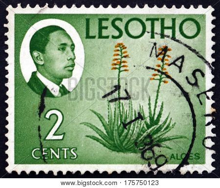 LESOTHO - CIRCA 1967: a stamp printed in the Lesotho shows King Moshoeshoe II and aloes circa 1967