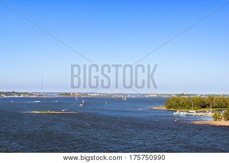 Sailing regatta in Bay of West harbor. Sailing ship yacht with white sails involved in water sports. Marine navigation in sunny summer day. Suomi Helsingfors Helsinki Finland