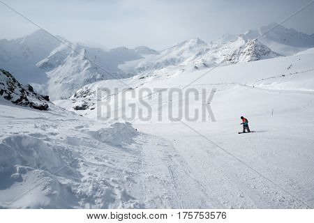 Elbrus Russia - January 31 2017: Ski on the Mount Elbrus with snowboarder top view.