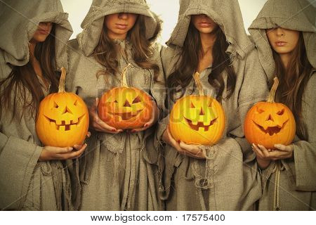 Four nuns with halloween pumpkins in their hands