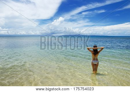Young Woman In Bikini Standing In Clear Water On Taveuni Island, Fiji