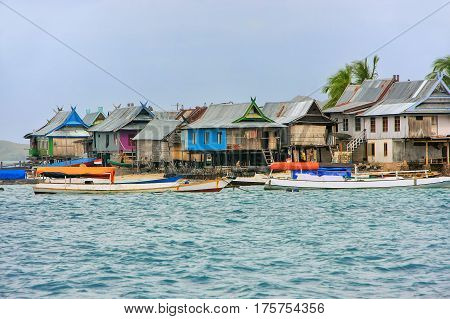 Typical village on small island in Komodo National Park Nusa Tenggara Indonesia. Komodo National Park is home to about 3500 people.