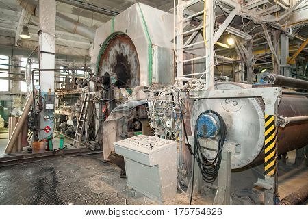 old production machine. old manufactory. fragment of the industrial machine. Inside in factory.