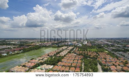 aerial view of home and house in village of land development outskirt of bangkok thailand on cloudy day