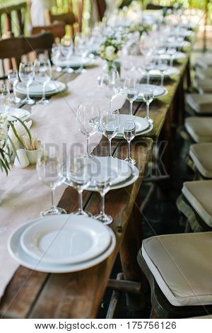 Glasses on the festive table setting. Wedding table decor. Table setting in classic style, setout.