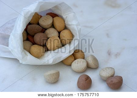 Dry dog food in white paper bag