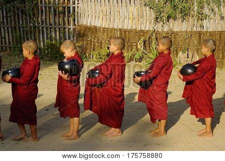 Buddhist Monk Walking For Alms In The Morning