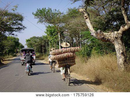 People On Rural Road In Bagan, Myanmar