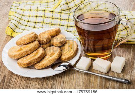 Puff Cookies In Plate, Hot Tea, Teaspoon And Lumpy Sugar