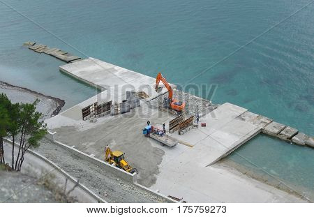 Construction of a pier and breakwater at sea