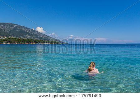 Brac Croatia - May 07 2016: tourist swimming at Zlatni Rat beach Croatia