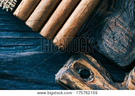 Cigar tips combined with textured wood cutting boards. Close-up top view