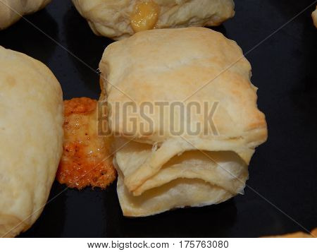 Puff pastry, sausages in dough and puffs