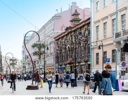 MOSCOW - AUGUST 26 2016: People walking on Myasnitskaya street with view to the Former Chinese Teahouse. This part of the oldest streets in the city was reconstructed in 2015 and became pedestrian.