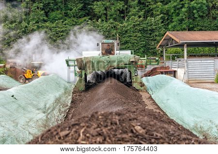 WEINFELDEN SWITZERLAND - JUNE 22 2010: Aerating compost in industrial environment