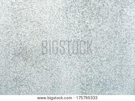 Galvanized steel sheet background in three shades of gray.