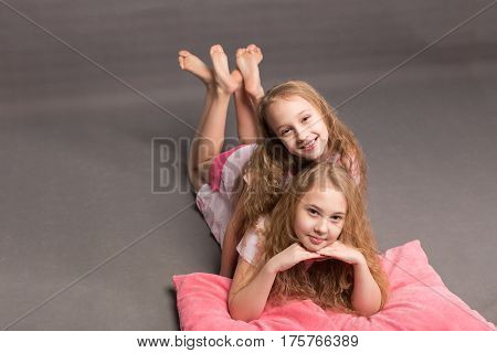 Beautiful Two Girls In Pink Pajamas Play Before Going To Bed