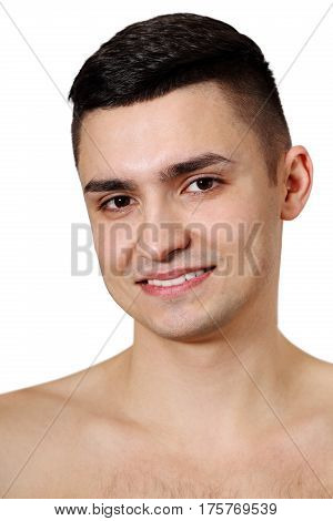 Young handsome man with a clean-shaven skin. Isolated on white