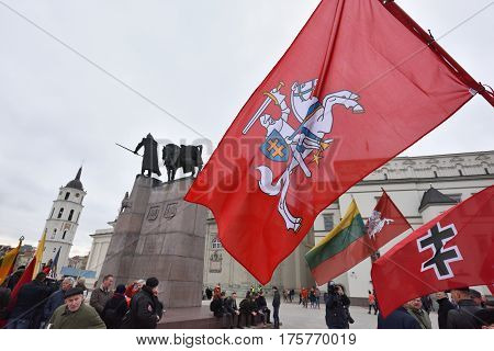 VILNIUS LITHUANIA - MAR 11: Around one thousand people gathered with flags in a nationalist rally at Gedimino Avenue on Re-Establishment of Independence Day on March 11 2017 in Vilnius Lithuania