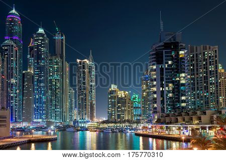 Dubai downtown night scene with city lights, luxury new high tech town in middle East.