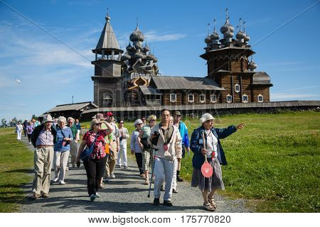 ISLAND OF KIZHI, RUSSIA - CIRCA JUNE: Tourists visiting the historical sights on the famous island of Kizhi, north of Russia. Architectural ensemble of Kizhi is on the UNESCO World Heritage List