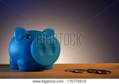 piggy bank on a wooden base wiih money