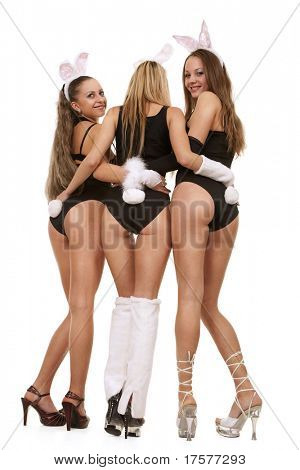 Three sexy playgirls in bunny costumes isolated on white