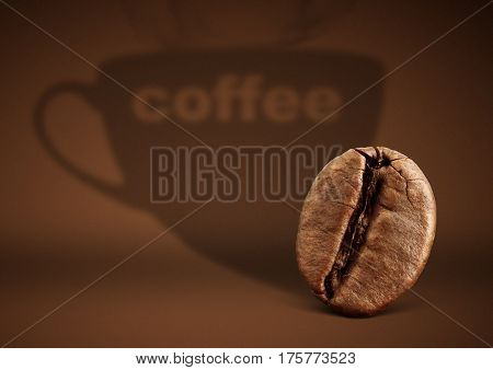 Coffee concept bean with cup shadow on brown