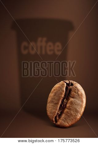 Coffee concept bean with paper cup shadow on brown