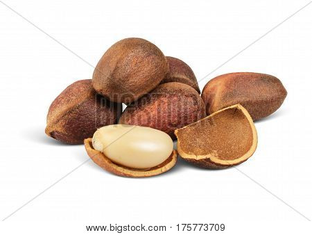 Close up pile of pine nuts isolated on white path