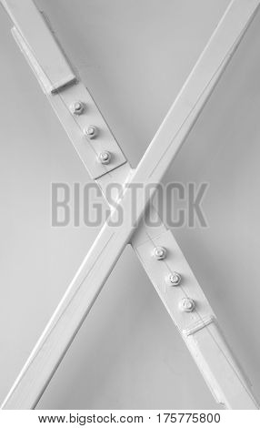 x letter painted beam metal structure shape