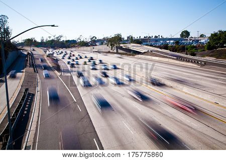 Long Beach, California 405 freeway traffic daytime slow shutter speed vehicles in motion. Overpass at Cherry avenue facing west