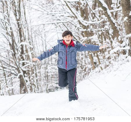 Child playing and having fun at winter snow
