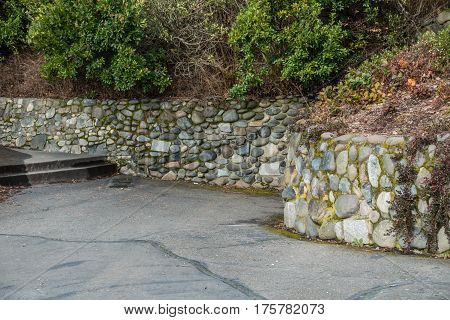 A view of a stone wall at Lincoln Park in West Seattle Washington.
