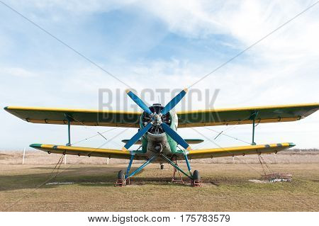 Small green airplane. Propeller close up photo.