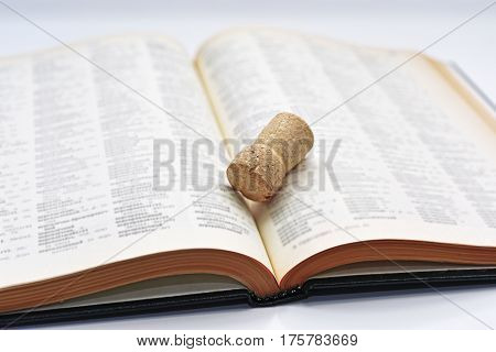 Old Book With Cork Of Wine