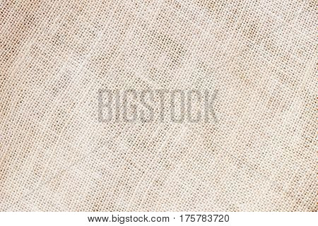 Sackcloth or burlap background with visible texture copy space for text and other web print design elements. Closeup of light natural sackcloth, canvas, fabric, jute, texture pattern for background