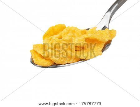 Spoon with cornflakes isolated on white