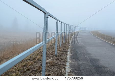Road with fog in the cold morning