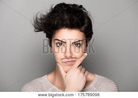 Confident Woman with Drawn Mustaches on Gray Background