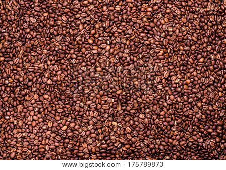 Coffee beans background. Texture. Roasted Arabic coffee. top view.