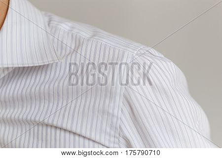 Leche and collar of a representative white shirt. Marvelous work of tailor