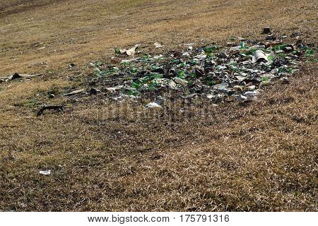 Nature Contaminated By Glass Metal Plastic Waste -  Pollution Concept