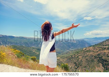 Beautiful Young Woman Standing In Front Of Splendid Mountain Background In Greece